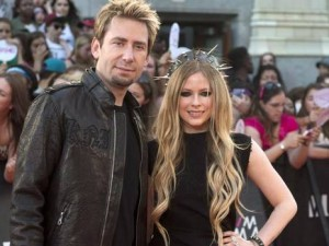 Chad Kroeger and Avril Lavigne soaking up the attention at the 2013 MTV Music Video Awards in Toronto, Canada. (Nathan Denette/THE CANADIAN PRESS)