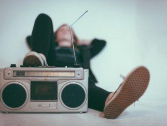 girl leaning on juke box