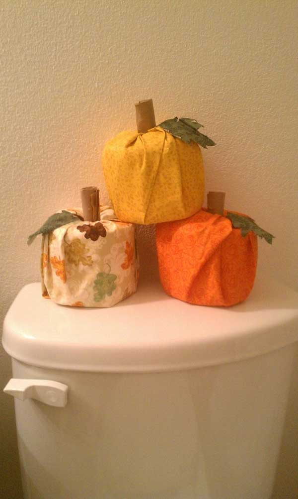 toilet paper covered to look like pumpkins